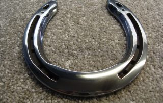 Gun metal black horse shoe