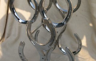 Chrome horse shoe wine rack