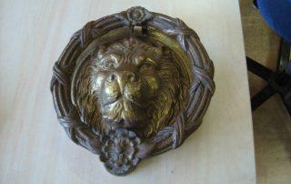 brass door knocker before